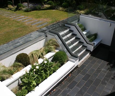 contemporary garden design, outdoor gas fire and retaining walls